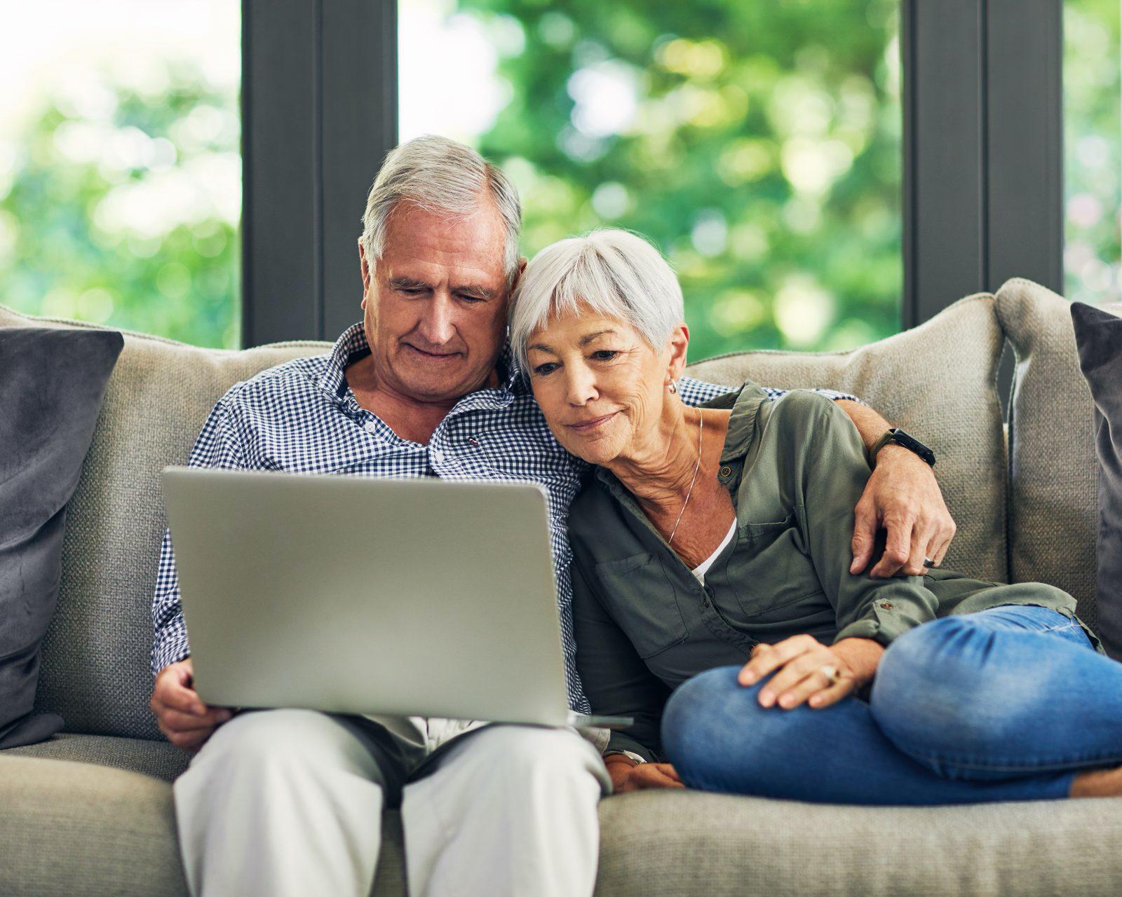 Couple reviewing finances on laptop